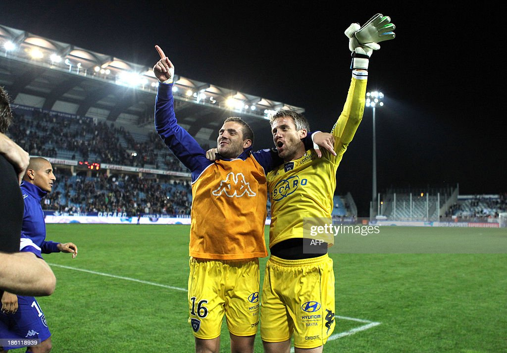 Bastia's French goalkeeper Mickael Landreau (R) and his substitute French Jean-Louis Leca celebrate after Bastia won 1-0 the French L1 football match Bastia (SCB) vs Nice (OGC) in the Armand Cesari stadium in Bastia, Corsica, on October 26, 2013.
