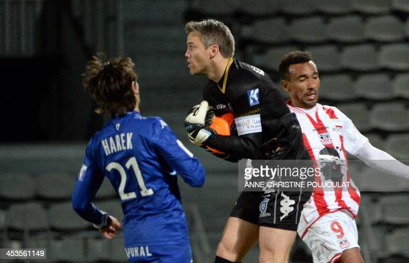 Bastia's French goalkeeper Mickael Landreau catche the ball during the French L1 football match Ajaccio vs Bastia on December 4 2013 at the Parsemain...