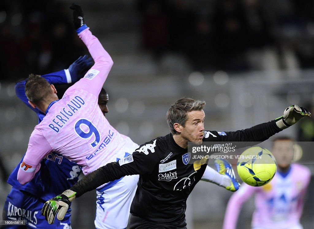 Bastia's French goalkeeper Mickael Landreau (R) fights for the ball with Evian's French forward Kevin Berigaud during the French L1 football match Bastia (SCB) vs Evian (ETGFC) at the Abbe Deschamps Stadium, on February 2, 2013 in Auxerre.