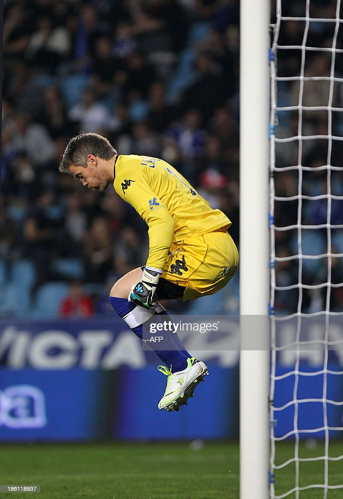 Bastia's French goalkeeper Mickael Landreau jumps during the French L1 football match Bastia (SCB) against Nice (OGC) in the Armand Cesari stadium in Bastia, Corsica, on October 26, 2013.