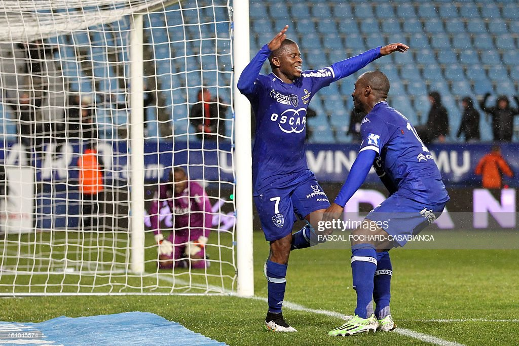 Bastia's French midfeilder <a gi-track='captionPersonalityLinkClicked' href=/galleries/search?phrase=Floyd+Ayite&family=editorial&specificpeople=5969808 ng-click='$event.stopPropagation()'>Floyd Ayite</a> is congratulated by teammates after scoring a goal during the French L1 football match Bastia (SCB) against Lille (LOSC) on February 21, 2015 in the Armand Cesari stadium in Bastia, French Mediterranean island of Corsica.