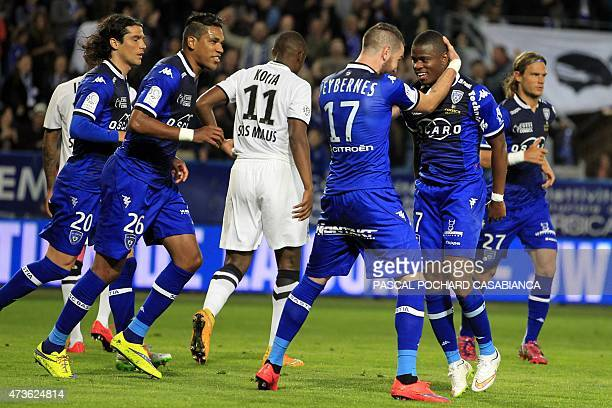 Bastia's French midfeilder Floyd Ayite is congratulated by teammates after scoring a goalduring the French L1 football match between Bastia and Caen...