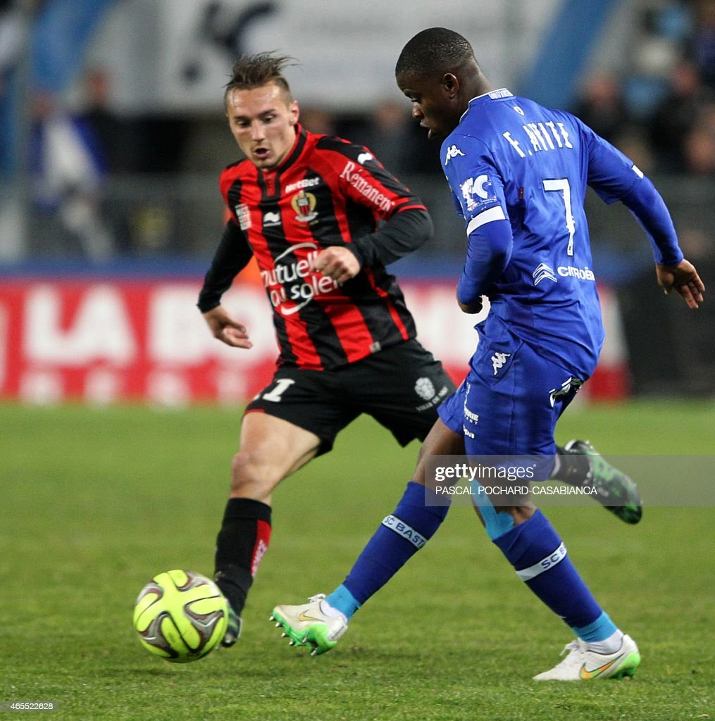 Bastia's French midfeilder <a gi-track='captionPersonalityLinkClicked' href=/galleries/search?phrase=Floyd+Ayite&family=editorial&specificpeople=5969808 ng-click='$event.stopPropagation()'>Floyd Ayite</a> (R) vies with Nice's French midfielder Eric Bautheac during the French L1 football match Bastia (SCB) against Nice (OGCN) on March 7, 2015 in the Armand Cesari stadium in Bastia, French Mediterranean island of Corsica.