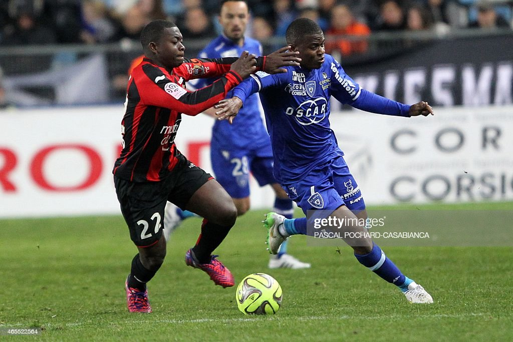 Bastia's French midfeilder <a gi-track='captionPersonalityLinkClicked' href=/galleries/search?phrase=Floyd+Ayite&family=editorial&specificpeople=5969808 ng-click='$event.stopPropagation()'>Floyd Ayite</a> (R) vies with Nice's French midfielder Nampalys Mendy during the French L1 football match Bastia (SCB) against Nice (OGCN) on March 7, 2015 in the Armand Cesari stadium in Bastia, French Mediterranean island of Corsica. AFP PHOTO / PASCAL POCHARD-CASABIANCA