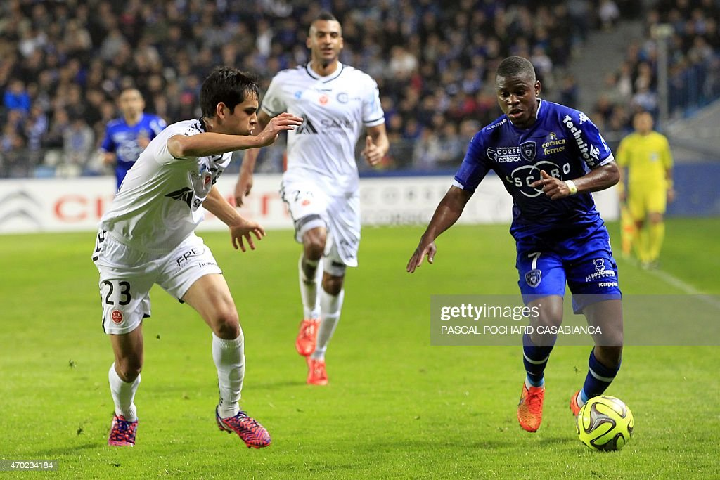 Bastia's French midfeilder <a gi-track='captionPersonalityLinkClicked' href=/galleries/search?phrase=Floyd+Ayite&family=editorial&specificpeople=5969808 ng-click='$event.stopPropagation()'>Floyd Ayite</a> vies with Reims' French Algerian defender Aissa Mandi during the French L1 football match Bastia (SCB) against Reims (SR) on April 18, 2015, in the Armand Cesari stadium in Bastia, on the French Mediterranean island of Corsica.