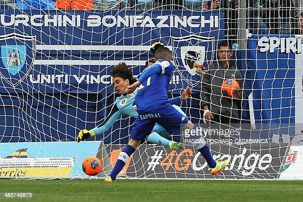 Bastia's French midfielder Florian Raspentino scores a goal past Ajaccio's Mexican goalkeeper Guillermo Ochoa during the French L1 football match...