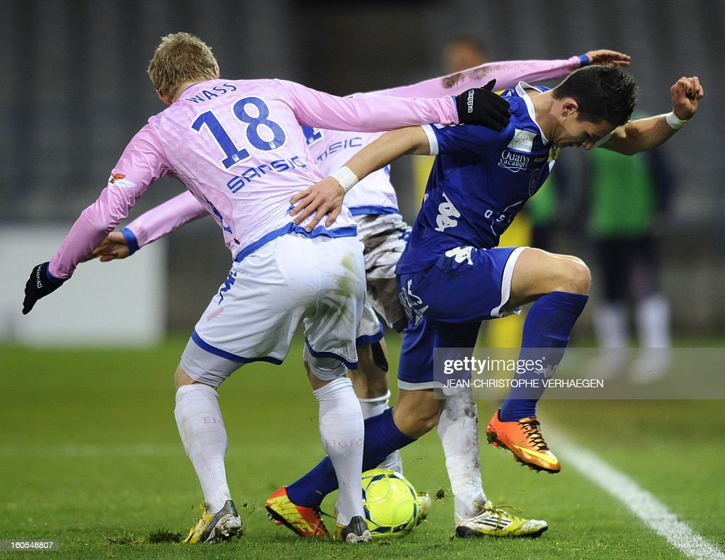 Bastia's French midfielder Florian Thauvin (R) fights for the ball with Evian's Danish defender Daniel Wass(L) during the French L1 football match Bastia (SCB) vs Evian (ETGFC) at the Abbe Deschamps Stadium, on February 2, 2013 in Auxerre.