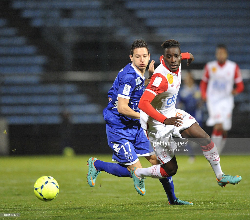 Bastia's French midfielder Florian Thauvin (L) vies for the ball with Nancy's French defender Massadio Haidara during the French L1 football match Bastia vs Nancy, on December 22, 2012, at the Jean Laville stadium in Gueugnon. AFP PHOTO / THIERRY ZOCCOLAN
