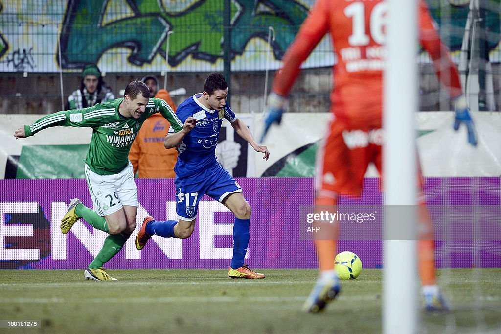 Bastia's French midfielder Florian Thauvin (C) vies with Saint-Etienne's French defender Francois Clerc (L) during the French L1 football match AS Saint-Etienne (ASSE) vs Bastia (SCB) on January 27, 2013, at the Geoffroy Guichard Stadium in Saint-Etienne, central France.