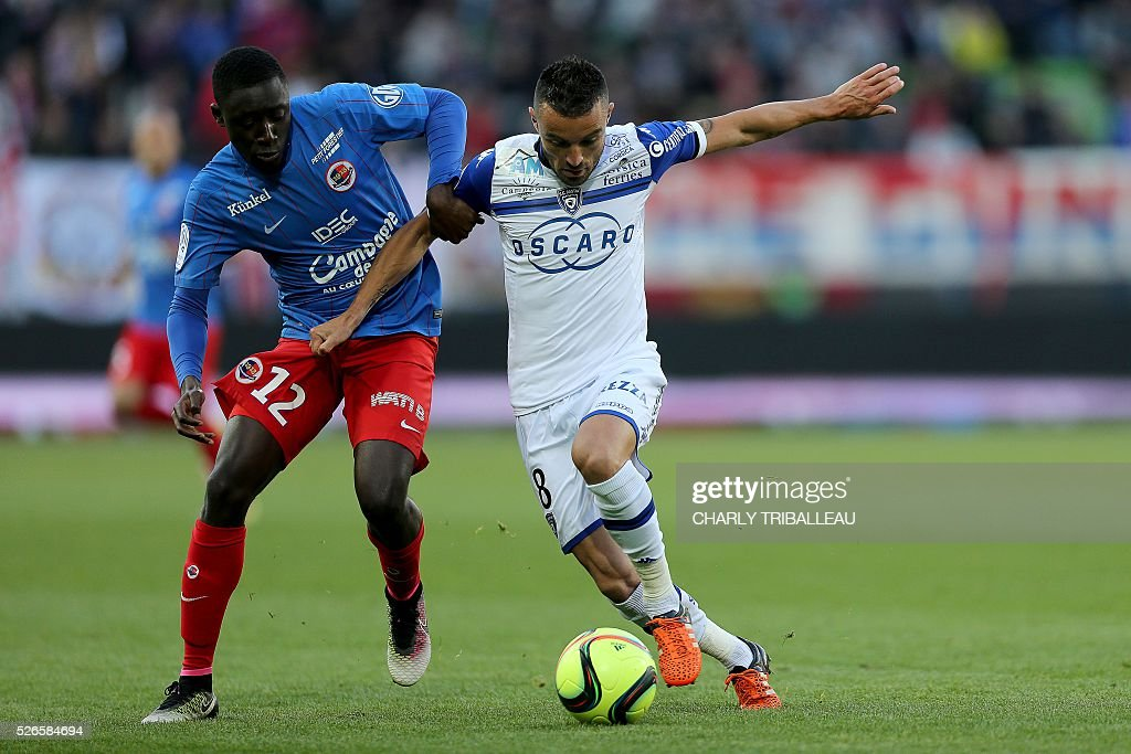 Bastia's French midfielder Gael Danic (R) vies for the ball with Caen's French defender Dennis Appiah (L) during the French L1 football match between Caen (SMC) and Bastia (SCB) on April 30, 2016, at the Michel d'Ornano Stadium in Caen, northwestern France.