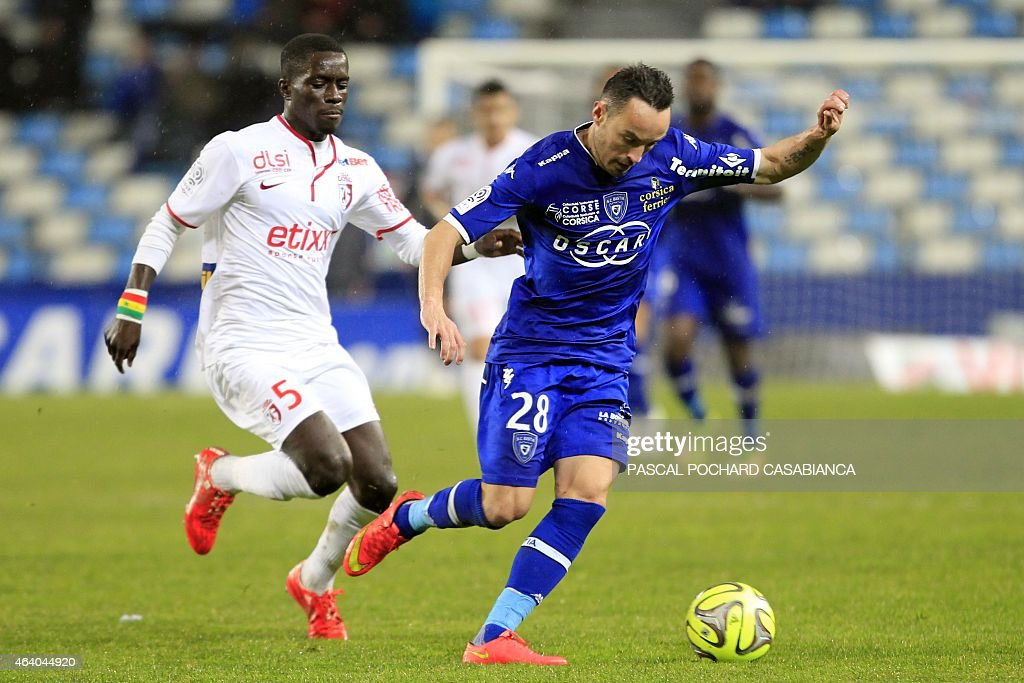 Bastia's French midfielder <a gi-track='captionPersonalityLinkClicked' href=/galleries/search?phrase=Gael+Danic&family=editorial&specificpeople=650403 ng-click='$event.stopPropagation()'>Gael Danic</a> vies with Lille's Senegalese midfielder Idrissa Gueye during the French L1 football match Bastia (SCB) against Lille (LOSC) on February 21, 2015 in the Armand Cesari stadium in Bastia, French Mediterranean island of Corsica.