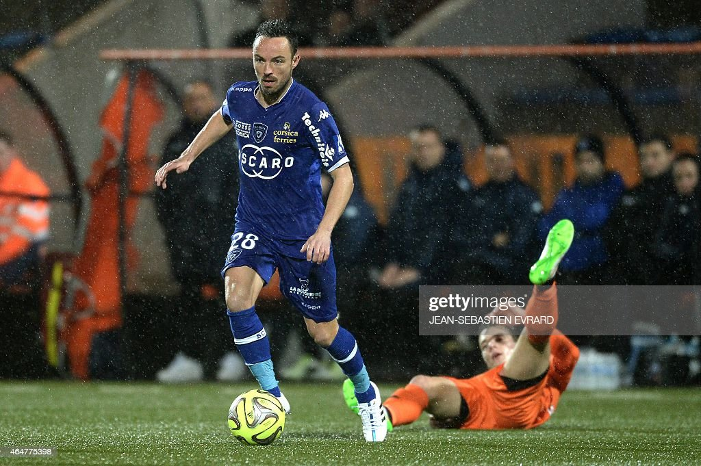 Bastia's French midfielder <a gi-track='captionPersonalityLinkClicked' href=/galleries/search?phrase=Gael+Danic&family=editorial&specificpeople=650403 ng-click='$event.stopPropagation()'>Gael Danic</a> (L) vies with Lorient's French forward Benjamin Jeannot during the French L1 football match between Lorient and Bastia on February 27, 2015 at the Moustoir stadium in Lorient, western France.