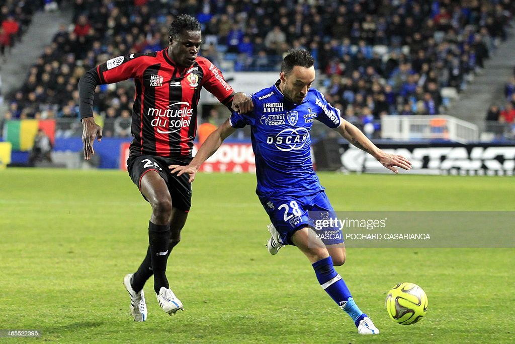 Bastia's French midfielder <a gi-track='captionPersonalityLinkClicked' href=/galleries/search?phrase=Gael+Danic&family=editorial&specificpeople=650403 ng-click='$event.stopPropagation()'>Gael Danic</a> (R) vies with Nice's French Haitian defender Romain Genevois during the French L1 football match Bastia (SCB) against Nice (OGCN) on March 7, 2015 in the Armand Cesari stadium in Bastia, French Mediterranean island of Corsica.
