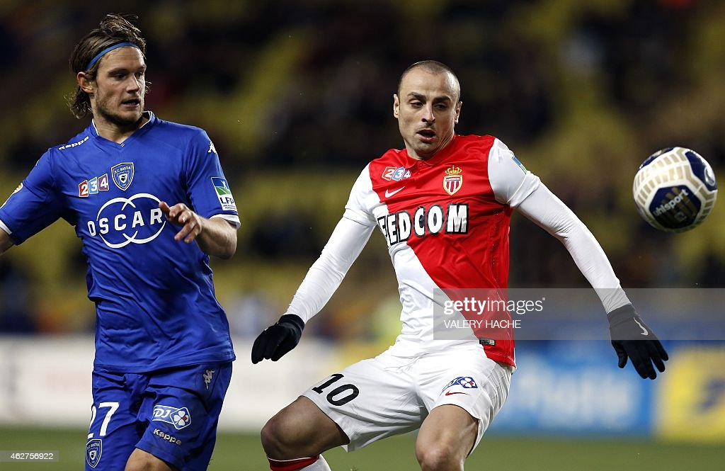 Bastia's French midfielder <a gi-track='captionPersonalityLinkClicked' href=/galleries/search?phrase=Guillaume+Gillet&family=editorial&specificpeople=4542498 ng-click='$event.stopPropagation()'>Guillaume Gillet</a> (L) vies with Monaco's Bulgarian forward <a gi-track='captionPersonalityLinkClicked' href=/galleries/search?phrase=Dimitar+Berbatov&family=editorial&specificpeople=216379 ng-click='$event.stopPropagation()'>Dimitar Berbatov</a> (R) during a French League Cup football match between Monaco (ASM) and Bastia (SCB) at the Louis II stadium in Monaco on February 4, 2015.