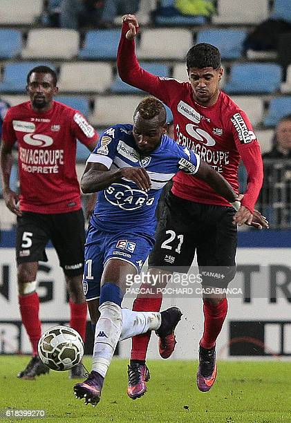 Bastia's French midfielder Lenny Nangis challenges Guingamp's French midfielder Ludovic Blas during the French League Cup football match between...