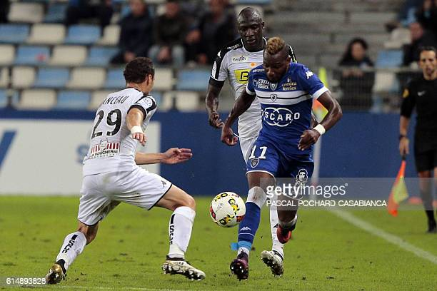 Bastia's French midfielder Lenny Nangis vies with Angers' French defender Vincent Manceauduring the French Ligue 1 football match between Bastia and...