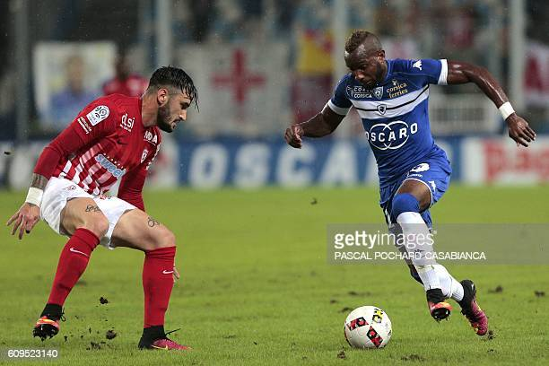 Bastia's French midfielder Lenny Nangis vies with Nancy's defender Erick Cabaco Almada during the French Ligue 1 football match between Bastia and...