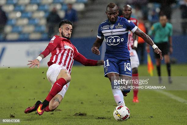 Bastia's French midfielder Lenny Nangis vies with Nancy's forward Erick Cabaco Almada during the French L1 football match between Bastia and Nancy on...
