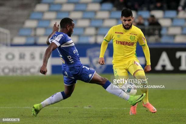 Bastia's French midfielder Lenny Nangis vies with Nantes' Brazilian defender Lima during the French L1 football match Bastia vs Nantes on March 1...