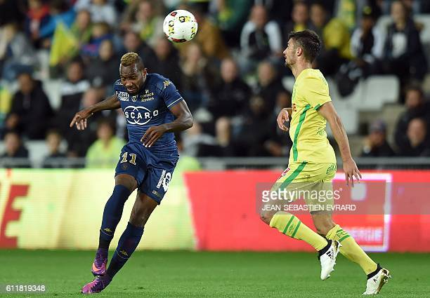Bastia's French midfielder Lenny Nangis vies with Nantes' French defender Leo Dubois during the French L1 football match between FC Nantes and SC...