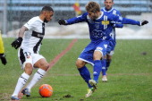 Bastia's French midfielder Mathias Lambrich vies for the ball with Rennes' French midfielder Yann M'vila during the French L1 football match between...