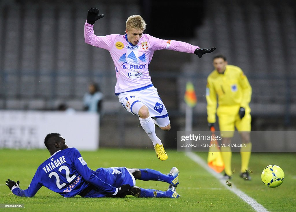 Bastia's French midfielder Sambou Yatabare (L) vies with Evian's Danish defender Daniel Wass (R) during a French L1 football match between Bastia (SCB) and Evian (ETGFC) at the Abbe Deschamps Stadium on February 2, 2013 in Auxerre.