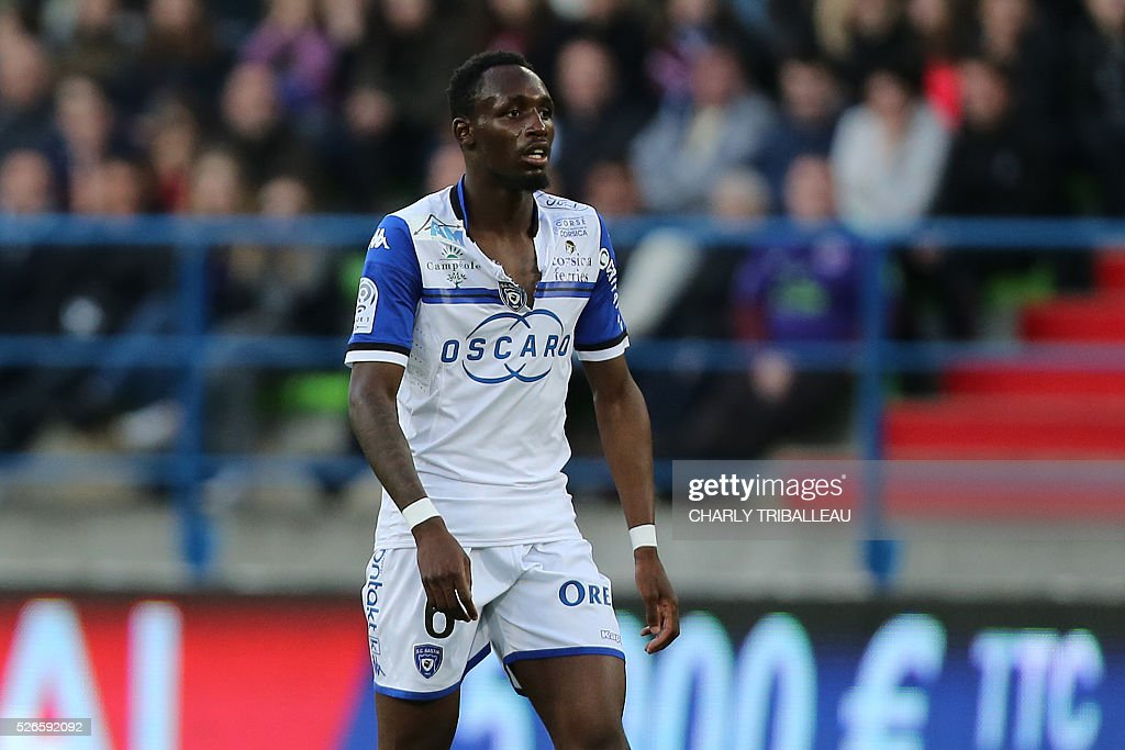 Bastia's French midfielder Seko Fofana walks with his torn jersey during the French L1 football match between Caen (SMC) and Bastia (SCB) on April 30, 2016, at the Michel d'Ornano Stadium in Caen, northwestern France.