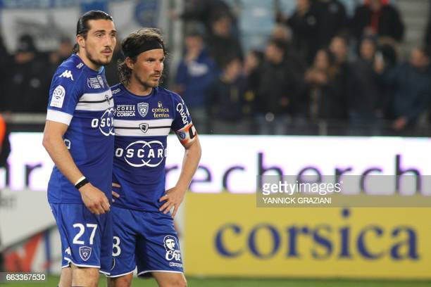 Bastia's French midfielder Yannick Cahuzac and Bastia's French forward Enzo Crivelli react after the L1 football match Bastia against Lille on April...