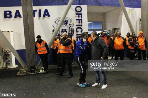 Bastia's French midfielder Yannick Cahuzac speaks on his mobile phone as Bastia's supporters block the access to the stadium after the L1 football...