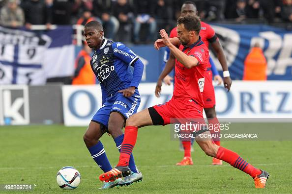 Bastia's FrenchTogolese midfielder Floyd Ayite vies with Ajaccio's French midfielder Jerome Le Moigne during the L1 football match Bastia against...