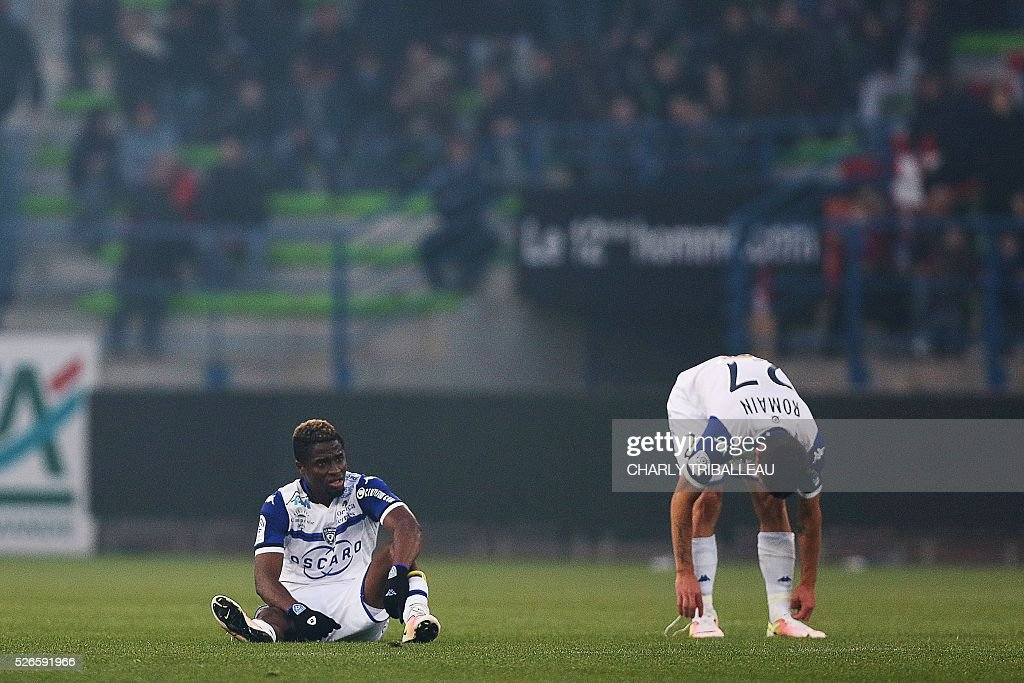 Bastia's Guinean forward Francois Kamano (L) and Bastia's French forward Julien Romain react during during the French L1 football match between Caen (SMC) and Bastia (SCB) on April 30, 2016, at the Michel d'Ornano Stadium in Caen, northwestern France.