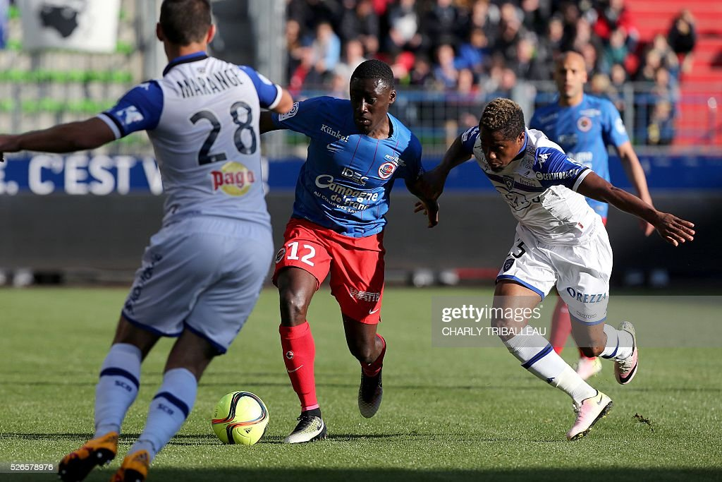 Bastia's Guinean forward Francois Kamano (R) vies for the ball with Caen's French defender Dennis Appiah during the French L1 football match between Caen (SMC) and Bastia (SCB) on April 30, 2016, at the Michel d'Ornano Stadium in Caen, northwestern France.