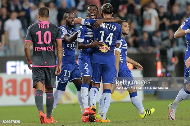 Bastia's Guinean forward Sadio Diallo celebrates with Bastia's French and Algerian defender Mehdi Mostefa after scoring a goal during the French...