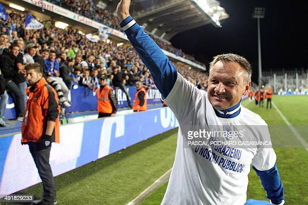 Bastia's head coach Frederic Hantz is congratulated by a team staff member at the end of the French L1 football match between Bastia and Nantes on...