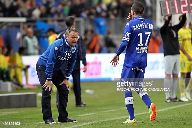 Bastia's head coach Frederic Hantz speaks to Bastia's French midfielder Florian Raspentino during the French L1 football match between Bastia and...