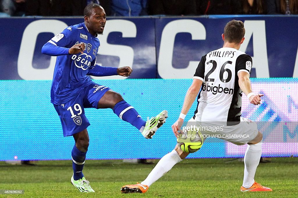 Bastia's Ivorian forward <a gi-track='captionPersonalityLinkClicked' href=/galleries/search?phrase=Giovanni+Sio&family=editorial&specificpeople=7023343 ng-click='$event.stopPropagation()'>Giovanni Sio</a> kicks the ball past Metz's Luxembourger defender Chris Philipps during the French L1 football match Bastia (SCB) vs Metz (FCM) on February 7, 2015 at the Armand Cesari stadium in Bastia, French Mediterranean island of Corsica.