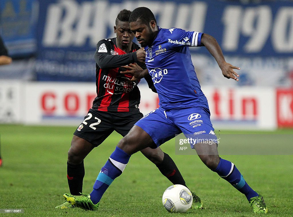 Bastia's Ivory Coast midfielder Romaric N Dri Koffi (R) vies with Nice's French midfielder Nampalys Mendy during the French L1 football match Bastia (SCB) against Nice (OGC) in the Armand Cesari stadium in Bastia, Corsica, on Octoer 26, 2013.