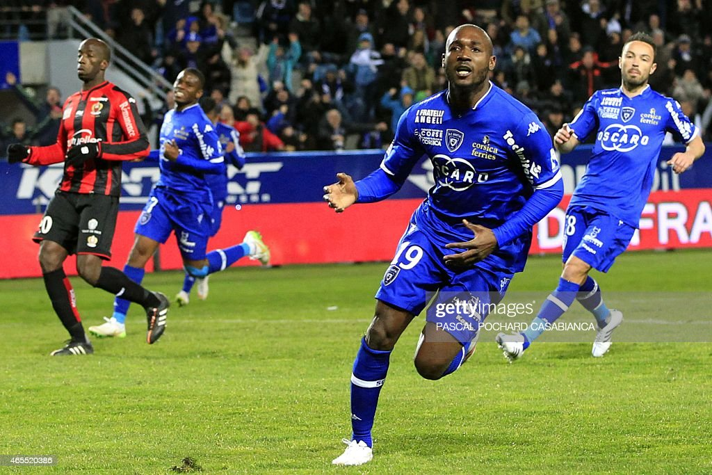 Bastia's Ivory Cost forward <a gi-track='captionPersonalityLinkClicked' href=/galleries/search?phrase=Giovanni+Sio&family=editorial&specificpeople=7023343 ng-click='$event.stopPropagation()'>Giovanni Sio</a> celebrates (C) after scoring a goal during the French L1 football match Bastia (SCB) against Nice (OGCN) on March 7, 2015 in the Armand Cesari stadium in Bastia, French Mediterranean island of Corsica.