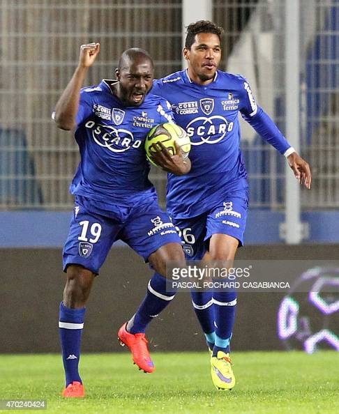 Bastia's Ivory Cost forward Giovanni Sio is congratulated by Bastia's Brazilian forward Brandao after scoring a goal during the French L1 football...
