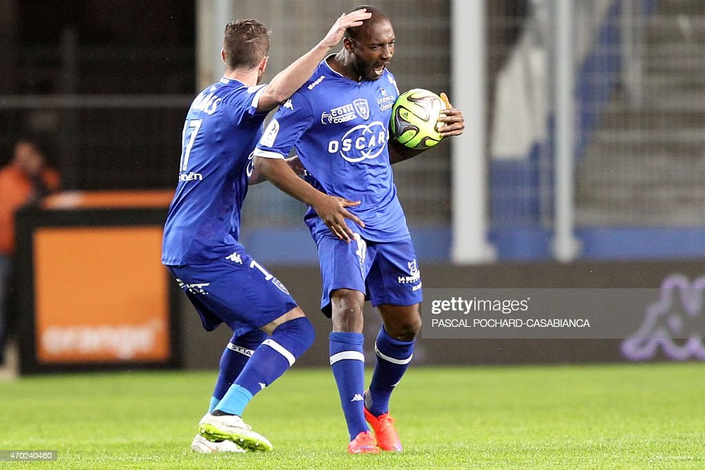 Bastia's Ivory Cost forward <a gi-track='captionPersonalityLinkClicked' href=/galleries/search?phrase=Giovanni+Sio&family=editorial&specificpeople=7023343 ng-click='$event.stopPropagation()'>Giovanni Sio</a> is congratulated by teammates after scoring a goal during the French L1 football match Bastia (SCB) against Reims (SR) on April 18, 2015 at the Armand Cesari stadium in Bastia, on the French Mediterranean island of Corsica.