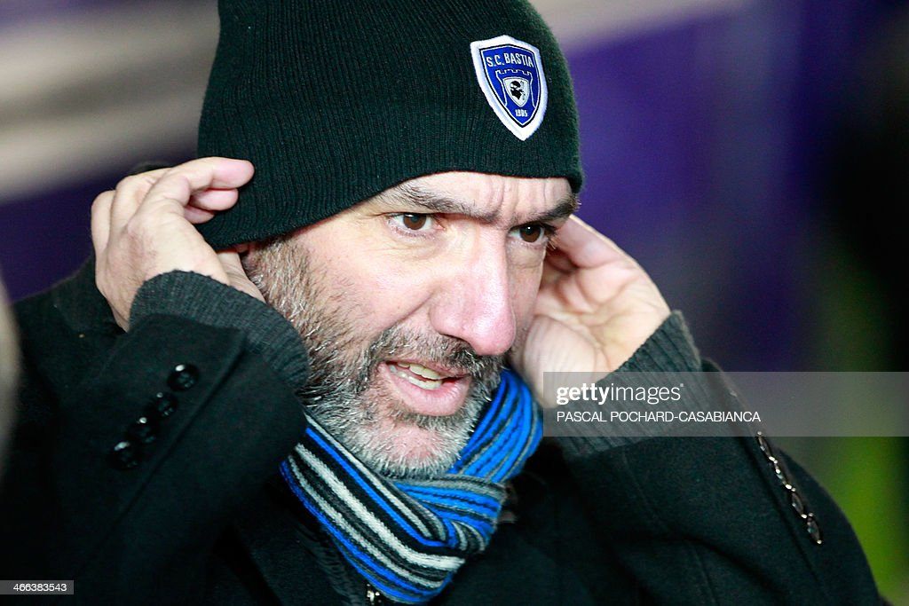 Bastia's L1 football team president Pierre-Marie Geronimi adjusts his bonnet as he is seated on the bench during the match Bastia (SCB) against Guingamp (AEG) in the Armand Cesari stadium in Bastia, in the French Mediterranean Island of Corsica, on February 1 , 2014.