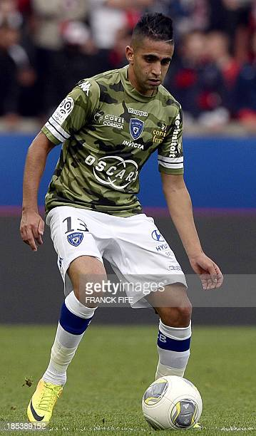 Bastia's midfielder Ryad Boudebouz controls the ball during the French L1 football match Paris Saint Germain against Bastia on October 19 2013 at the...