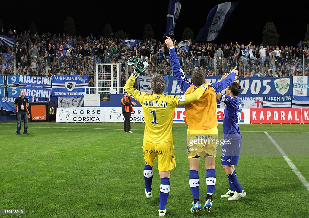 Bastia's players celebrate after winning 1-0 in the French L1 football match Bastia (SCB) against Nice (OGC) in the Armand Cesari stadium in Bastia, Corsica, on October 26, 2013.