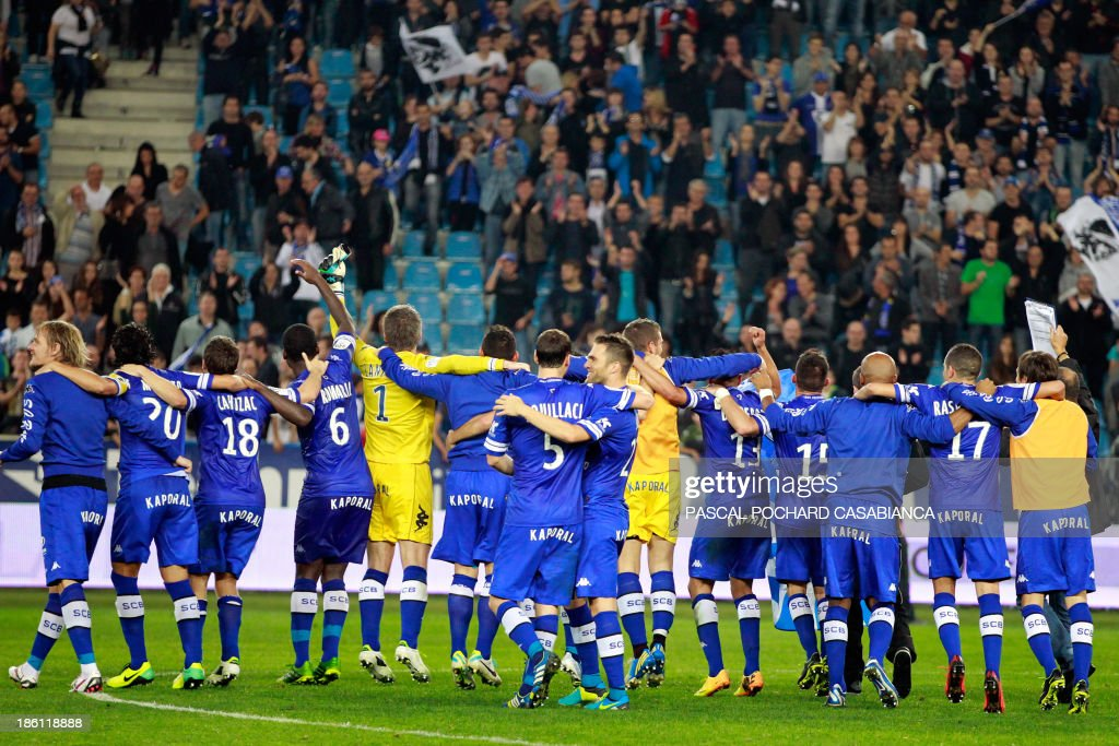 Bastia's players celebrate after winning 1-0 the French L1 football match Bastia (SCB) against Nice (OGC) in the Armand Cesari stadium in Bastia, Corsica, on October 26, 2013.