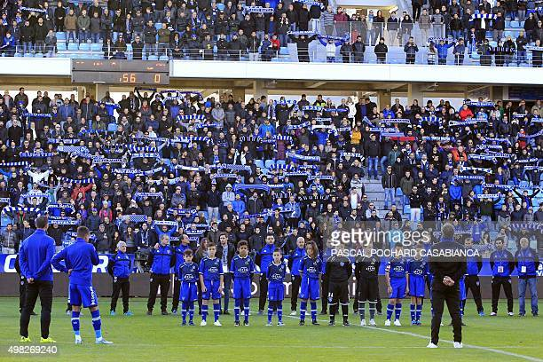 Bastia's players listen to the French national anthem La Marseillaise prior to the start of the L1 football match Bastia against Gazelec Ajaccio on...