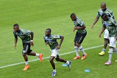 Bastia's players warm up prior to the French L1 footbal match Bordeaux vs Bastia on August 31 2014 at the ChabanDelmas stadium in Bordeaux...