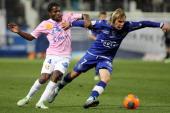 Bastia's Serbian midfielder Milos Krasic vies with Evian's Ivoirian midfielder Eric Tie Bi during the French L1 football match Bastia against Evian...