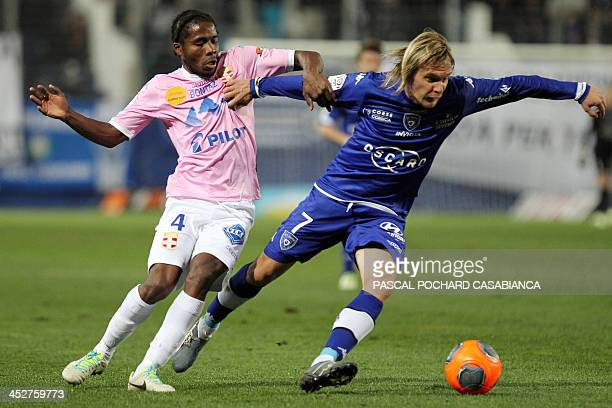 Bastia's Serbian midfielder Milos Krasic vies with Evian's Ivoirian midfielder Eric Tie Bi during the French L1 football match Bastia against Evian...