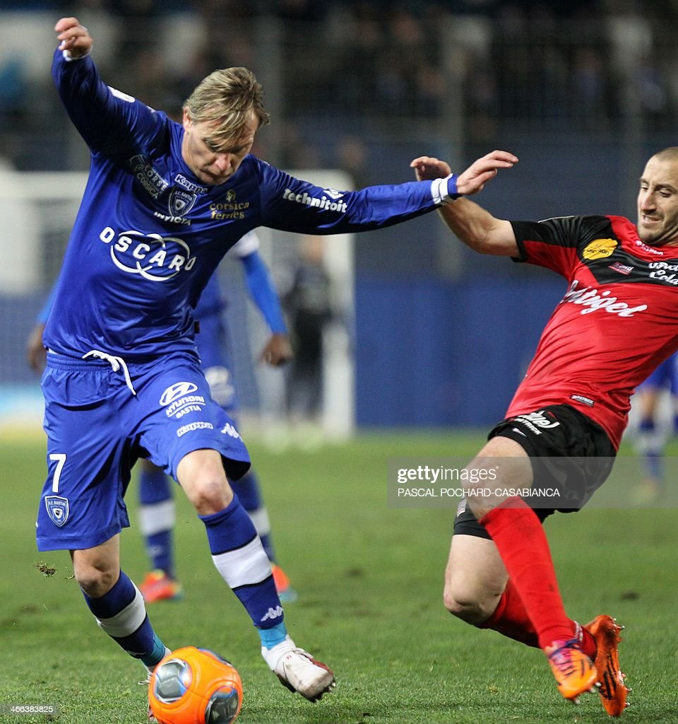 Bastia's Serbian midfielder Milos Krasic (L) vies with Guingamp's French midfileder and captain Lionel Mathis during the French L1 football match Bastia (SCB) against Guingamp (AEG) in the Armand Cesari stadium in Bastia, in the French Mediterranean Island of Corsica, on February 1 , 2014.