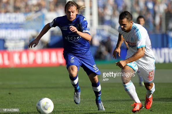 Bastia's Serbian midfielder Milos Krasic vies with Marseille's French midfielder Raffidine Abdullah during the French Ligue1 football match Bastia vs...